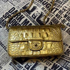 Chanel gold embossed crocodile mini 2019 metiers